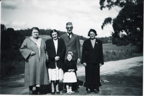Mary and Lily are to the right with my grandparents. That is my mum as a child
